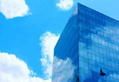 Blue glass building. On a background of blue sky Royalty Free Stock Image
