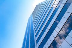 Blue glass building. With sky and clouds reflection Royalty Free Stock Images