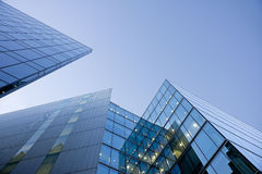 Blue glass buildings on blue sky Stock Images