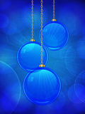Blue glass Christmas bauble background. Blue glass christmas baubles on a glowing background Stock Images