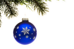 Blue Glass Christmas Ornament. On tree isolated on white stock image