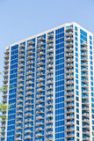 Blue Glass Condo Tower with White Balconies Royalty Free Stock Photography