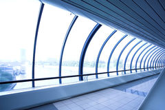 Blue glass corridor Stock Photos