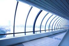 Blue glass corridor stock photos