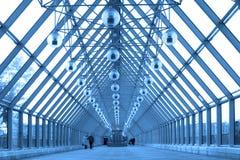 Blue glass corridor in bridge Royalty Free Stock Images