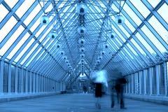Blue glass corridor in bridge Royalty Free Stock Photos