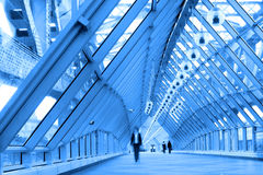 Blue glass corridor in bridge Stock Photo