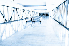 Blue glass corridor in office centre Royalty Free Stock Photos