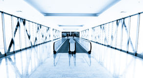 Blue glass corridor in office centre Stock Images