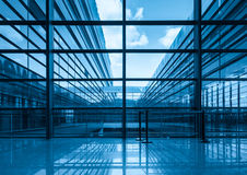 Blue glass curtain wall and window. In a modern building Royalty Free Stock Image