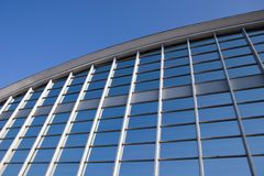 Blue Glass Grid. Modern office building glass wall and blue sky Royalty Free Stock Photos