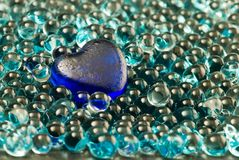 Blue glass heart and beads Stock Image