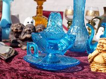 Blue glass items in a flea market Royalty Free Stock Photography