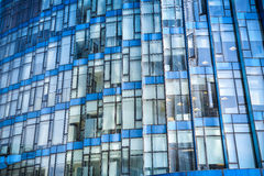 Blue glass modern building closeup. Blue glass window closeup ,modern office building background Stock Images
