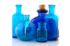 Blue glass objects. Several blue glass objects in a row isolated over white royalty free stock image