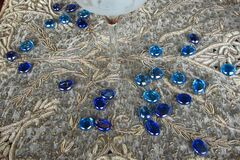 blue glass pebbles on lace Royalty Free Stock Images