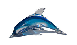 Blue glass porpoise on white table Stock Images