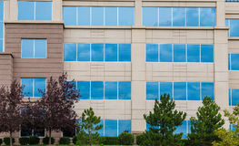 Blue Glass Reflecting Sky in Stone Building Royalty Free Stock Photography
