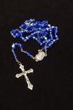 Blue glass rosary isolated on the dark background Stock Images