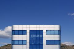 Blue glass and silver cubic architecture building Royalty Free Stock Images