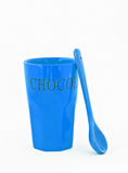 Blue glass with a spoon and the inscription isolated royalty free stock photography