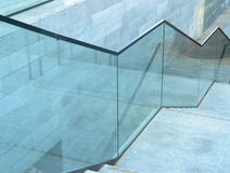 Blue glass stairs modern at day royalty free stock images
