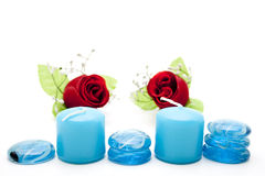 Blue glass stones with candles and roses Royalty Free Stock Photography