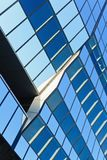 Blue glass surface of a modern office building royalty free stock photography