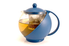 Blue glass tea-pot with warm tea royalty free stock images