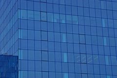 Blue glass texture of windows on the wall of a tall building Stock Photography
