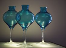 Blue glass vases. Three blue glass vases underlighted Stock Photography