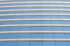 Blue glass wall of office building Royalty Free Stock Image