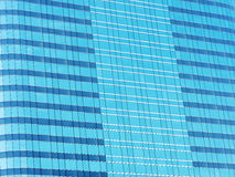 Blue glass wall of skyscraper, abstract background. Royalty Free Stock Photography