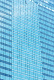 Blue glass wall of skyscraper, abstract background. Blue glass wall of skyscraper, abstract background Stock Photo