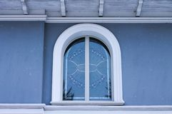 Blue glass window of a blue building Royalty Free Stock Images