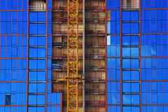 Blue Glass Windows reflect clouds with red lines framing windows Stock Photo