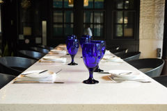 Blue Glass. Blue wineglasses on top of a table Stock Images
