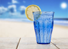 Blue Glass With Sparkling Water And Lemon Royalty Free Stock Images