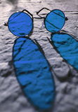 Blue glasses Stock Images