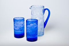 Blue glasses and jar Stock Image