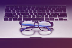 Blue glasses on laptop, close up - concept of rest from stress a stock photos
