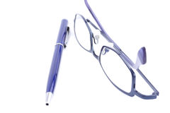 Blue glasses and pen. Isolated on the white background Stock Images