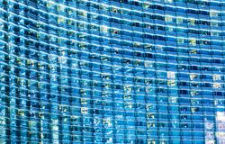 Blue Glassy Building. Background. Hundreds of Windows Architecture Backdrop. Modern Architecture stock image