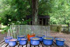 Blue glazed pots before erosion fencing Royalty Free Stock Image