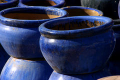 Blue glazed pottery. Big blue pottery standing outside in the evening sun royalty free stock image