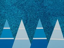 Blue glitter background with fir trees. Christmas concept. Copy space. Flat lay. Stock Photography