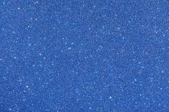 Blue glitter background. Sparkle texture. Abstract twinkle background for New Years or Christmas holiday royalty free stock photography