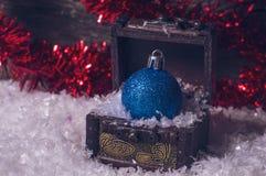 Blue glitter christmas ball Stock Images