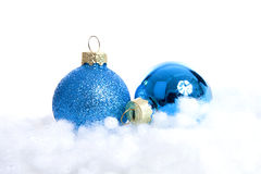 Blue glitter Christmas balls over white background Stock Images