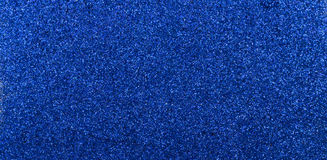 Blue glitter. Blue diamond dust as  glitter background ,bright and vibrant Royalty Free Stock Images